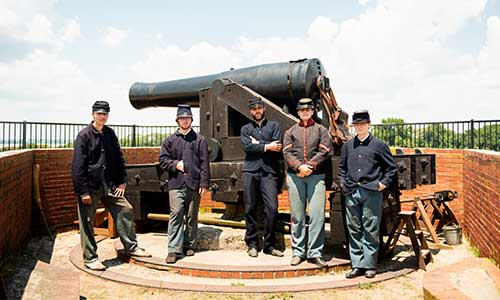Interpreters at Fort Delaware waiting to fire the Colombiad cannon