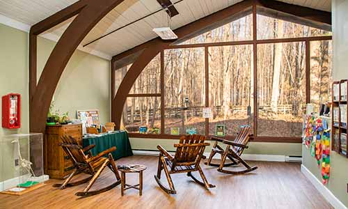 Rocking chairs await at the Whale Wallow Nature Center at Lums Pond State Park.