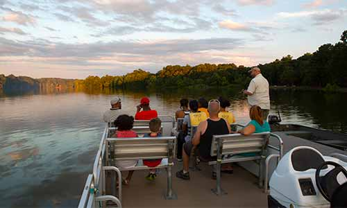 Passengers njoying a pontoon boat tour at Trap Pond State Park