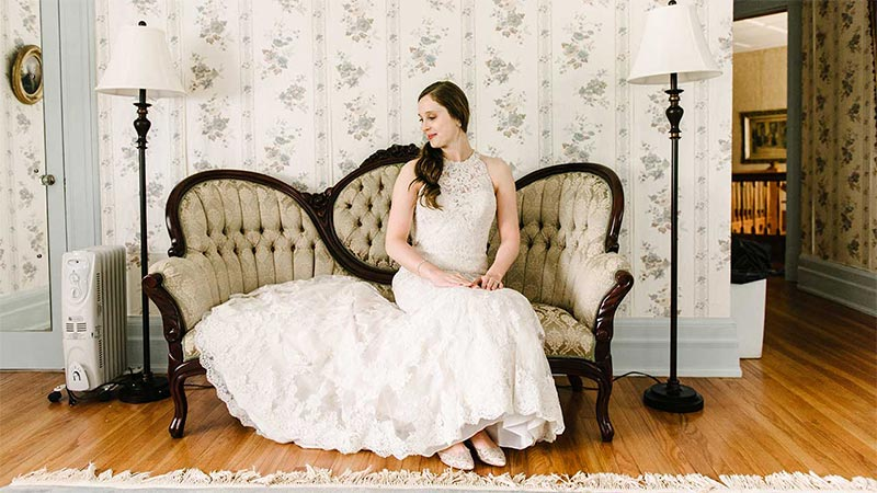 bride on couch with huge dress spread out