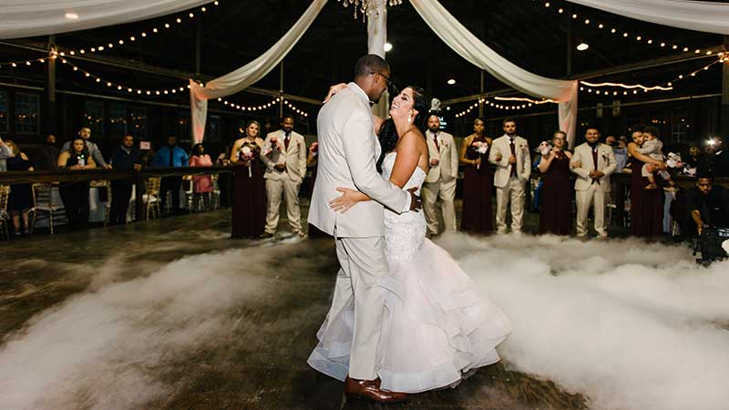 bride and groom on  dance floor with dry ice