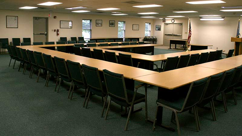 conference room with tables set up in a square around the room