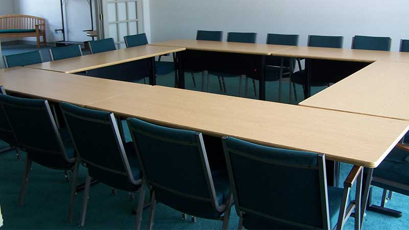 conference room with tables set up in a smaller square around the room