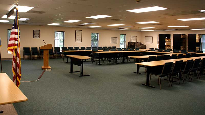 conference room with tables arranged in a U shape