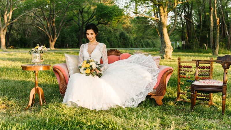 bride sitting at a picnic table