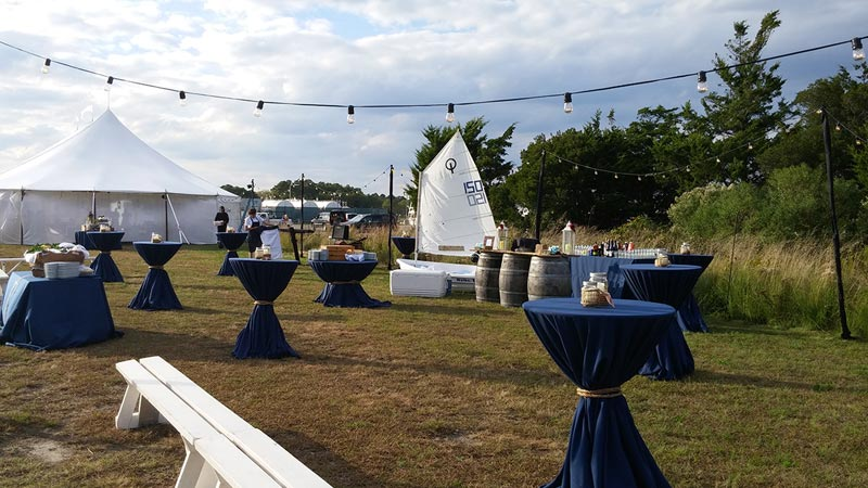 covered tables set up for outdoor wedding
