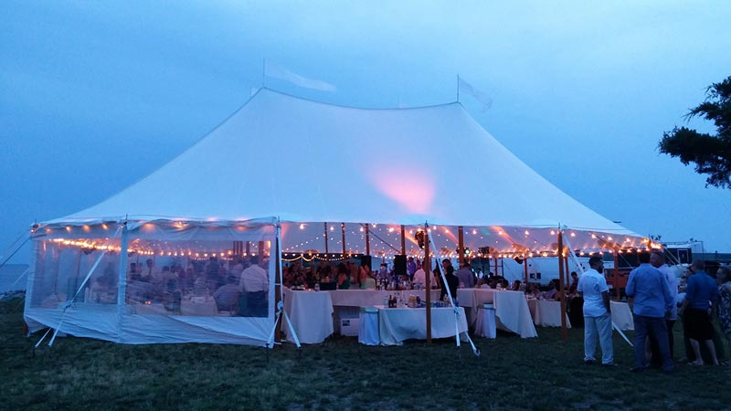 lit up party tent at dusk