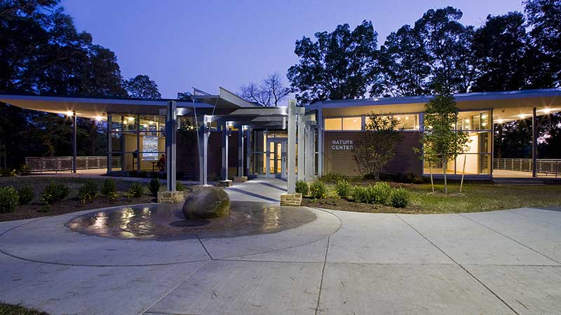 exterior view of the front of killens pond nature center at night