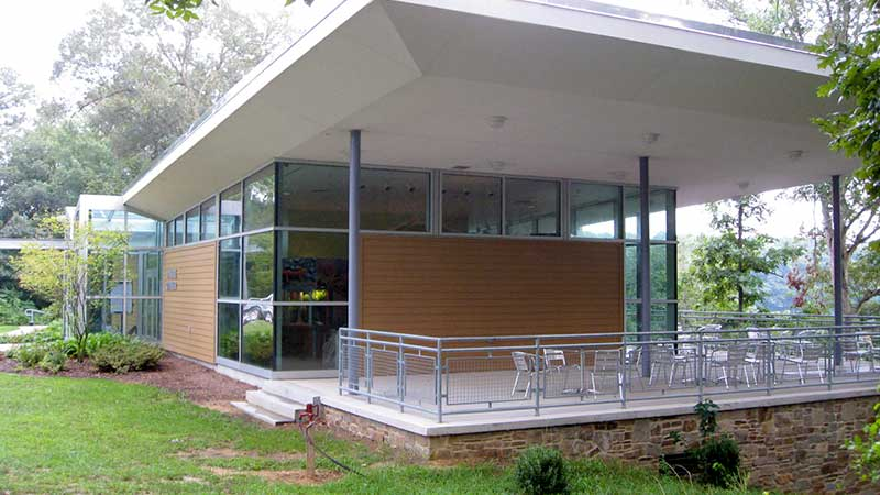 side view of exterior of nature center showing covered outdoor seating area