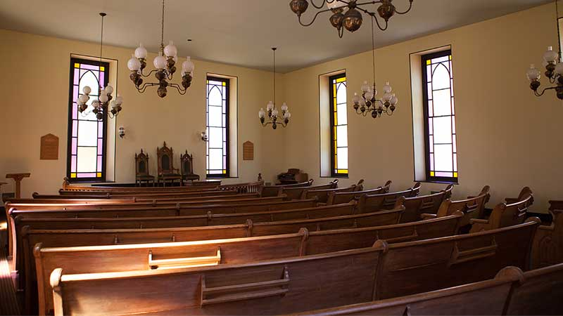 interior of meeting house with pews