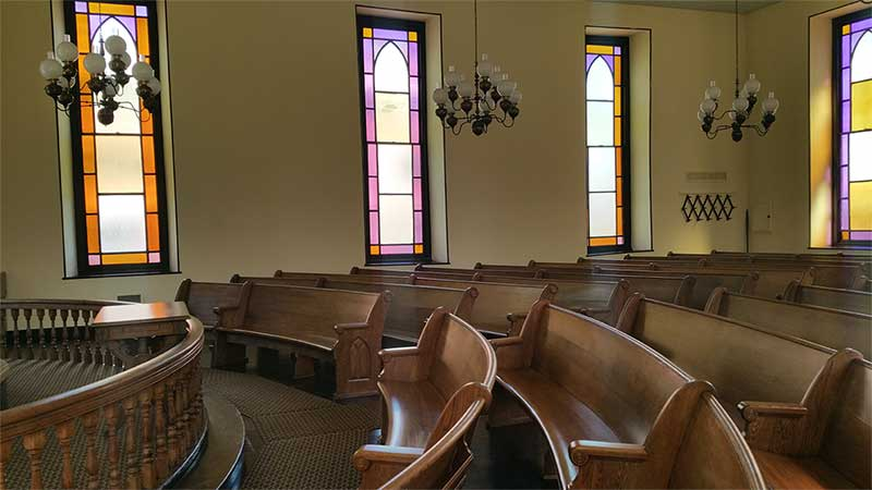 side view of curved pews in meeting house