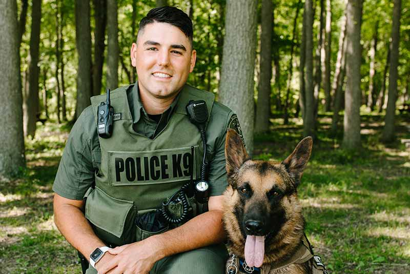 Officer Trevor Ditmore with K9 officer Leo